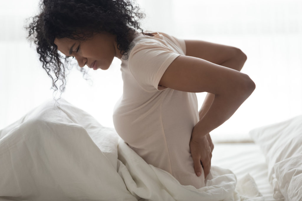 woman with back pain, mattress to relieve back pain, custom mattresses