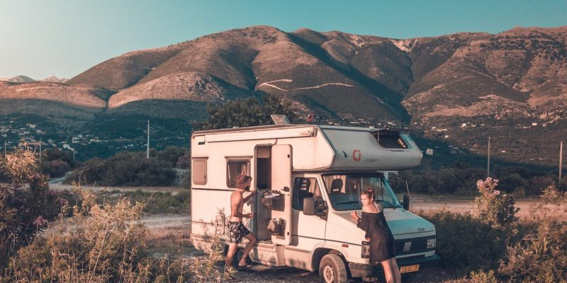 RV in front of mountains and sage