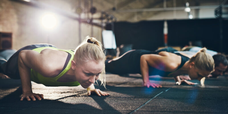 women doing push-ups - how sleep affects exercise